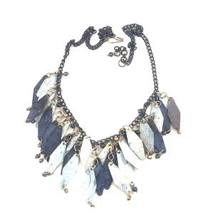 Metal chain necklace with greenish blue hues.